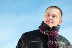 Young Man In Jacket Stands By Winter Day Stock Photos
