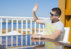 Free Young Man In Sea Restaurant Calling The  Waiter Royalty Free Stock Image - 69677416