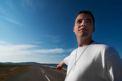 Young man indicate the way Stock Photo