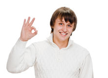 Young man indicating ok sign Royalty Free Stock Photo