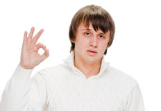 Young man indicating ok sign Royalty Free Stock Photos
