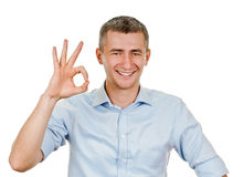 Young man indicating ok sign. Young man shows sign and symbol ok on white background Stock Images