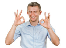 Young man indicating ok sign. Young man shows sign and symbol ok on white background Royalty Free Stock Photo