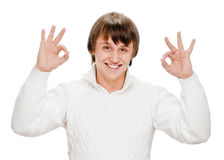Young man indicating ok sign. Young man shows sign and symbol ok on white background Royalty Free Stock Images
