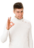 Young man indicating ok sign. Young man shows sign and symbol ok on white background Stock Photos