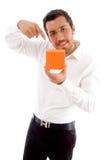 Young man indicating towards jewelery box Stock Image