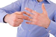 Man indicating his wedding ring. Stock Image