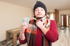 Young man with inflamed throat. Holding blister with pills in his hand Royalty Free Stock Images