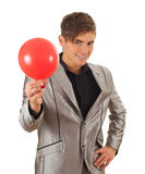 Young man with inflated balloon Stock Image