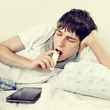 Young Man with Inhaler Royalty Free Stock Photo