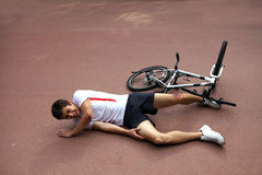 Young man injured during riding a bike Royalty Free Stock Photo