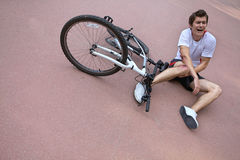 Young man injured during riding a bike Royalty Free Stock Photography