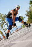 Young man with inline skates in summer outdoor Stock Photography