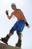 Young man with inline skates in summer outdoor Royalty Free Stock Photography