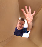 Young man inside box Royalty Free Stock Images