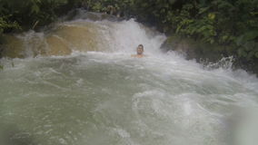 Young Man Inside a River Current stock video footage