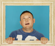 Young Man Inside Wooden Frame Stock Images
