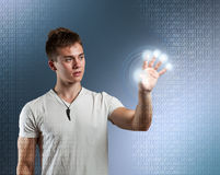 Young man with interface Stock Images