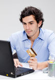 Young man internet shopping Stock Photo
