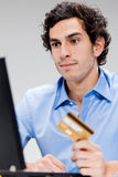 Young man internet shopping Royalty Free Stock Photos