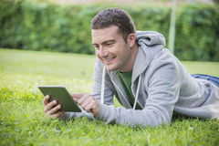 Young man internet tablet Royalty Free Stock Photography