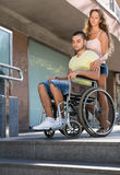 Young man on invalid chair Stock Photography
