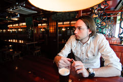 Young man in an Irish bar Stock Photo