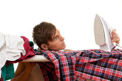 Young man ironing clothes Royalty Free Stock Photo