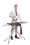 Young man ironing his pants Royalty Free Stock Photography