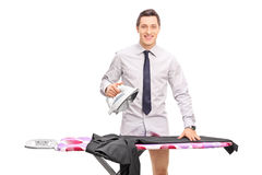 Young man ironing his pants Stock Photography