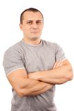 Young man isolated on white background. Fit young man with t-shirt and arms crossed isolated on white background Royalty Free Stock Photography
