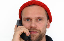 Young man isolated on white with phone Stock Photos