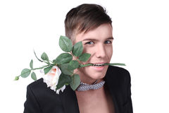Young man in a jacket with a flower Royalty Free Stock Image