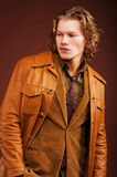 Young man in  jacket  isolated on brown background Stock Photo