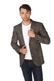 Young man with jacket over white background Royalty Free Stock Photo