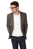 Young man with jacket over white background Stock Image