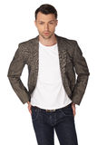 Young man with jacket over white background Royalty Free Stock Image