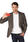 Young man with jacket over white background Royalty Free Stock Images