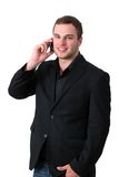 Young Man in jacket talking on the phone Stock Photo