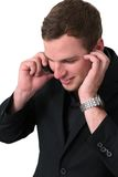 Young Man in jacket talking on the phone Royalty Free Stock Photos