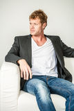 Young man in jeans and dinner jacket Royalty Free Stock Images