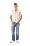 Young man in jeans and shirt Stock Images
