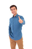 Young man in jeans shirt making the ok gesture Royalty Free Stock Images