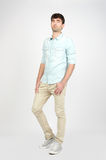 Young man jeans and shirt Royalty Free Stock Photo