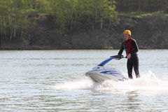 A young man on the jet ski. Stock Image