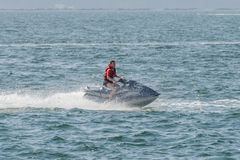 Young man on a jet ski on the sea. Image of young man on a jet ski on the sea Royalty Free Stock Photo
