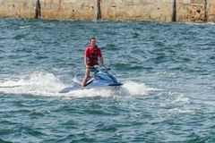 Young man on a jet ski on the sea. Image of young man on a jet ski on the sea Stock Photos