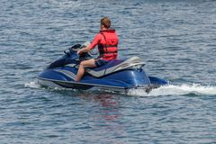 Young man on a jet ski on the sea. Image of young man on a jet ski on the sea Stock Photography