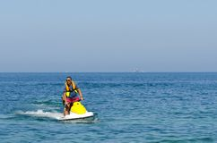 Young Man on Jet Ski. Tropical Ocean, Vacation Concept Stock Images