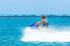 Young Man on Jet Ski. Tropical Ocean, Vacation Concept Royalty Free Stock Image